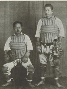 Kenwa Mabuni (seated) utilizingprotective equipment in his training